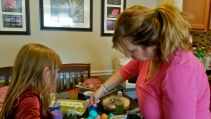 Mary and Lilly coloring eggs